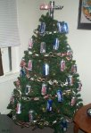 Found at: http://gallery.markheadrick.com/humorous/christmas-tree-with-beer-can-ornaments/