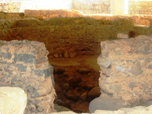 excavated portion of the earth thought to the the Apostle Peter's house in the fishing village, Capernaum